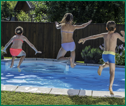Kids Jumping into Propane Heated Pool